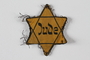 Star of David badge with Jude owned by Czech Jewish concentration camp prisoners