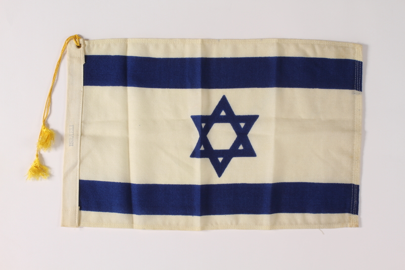 2011.447.4.2 front Tasseled Israeli Flag owned by an aid for the mayor of New York City