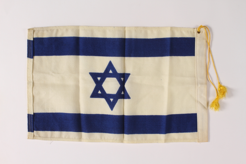2011.447.4.2 back Tasseled Israeli Flag owned by an aid for the mayor of New York City