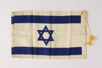2011.447.4.2 back Tasseled Israeli Flag owned by an aid for the mayor of New York City  Click to enlarge