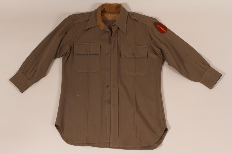 2011.447.2 a front US Army regulation uniform with a 63rd infantry sleeve patch worn by a Jewish soldier