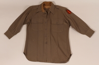 2011.447.2 a front US Army regulation uniform with a 63rd infantry sleeve patch worn by a Jewish soldier  Click to enlarge