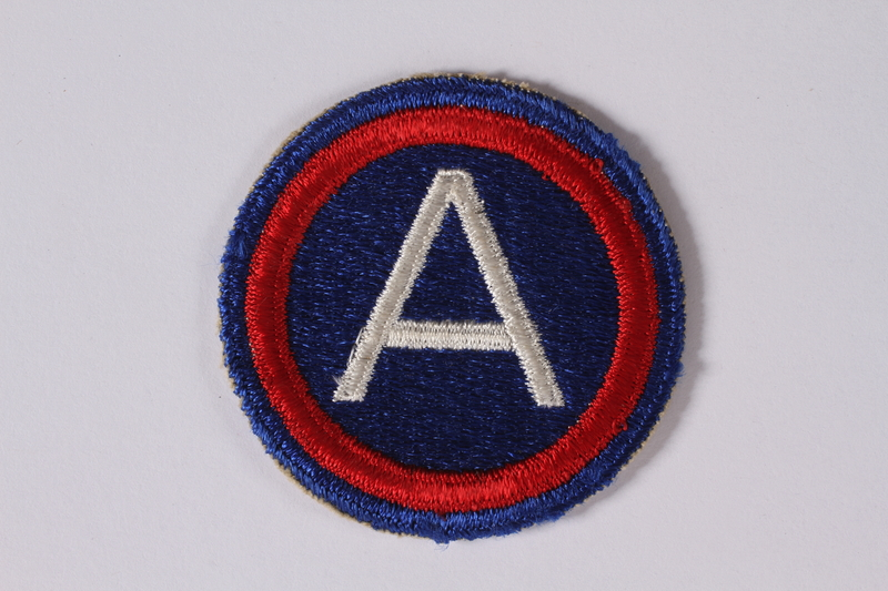2011.447.11.3 front US Third Army shoulder sleeve patch with an AO worn by a Jewish soldier
