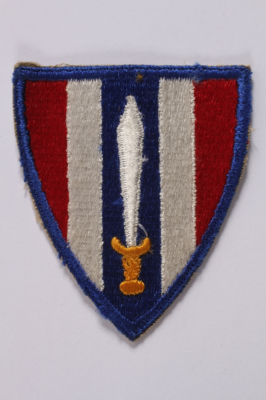 2011.447.11.4 front US Army, European Civil Affairs Division shoulder sleeve patch worn by a Jewish soldier