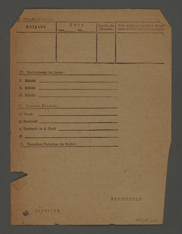 1995.89.600 back Kovno ghetto police permit/pass