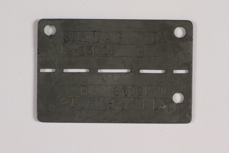 2014.427.5 front Prisoner ID tag issued to a Belgian soldier and former POW