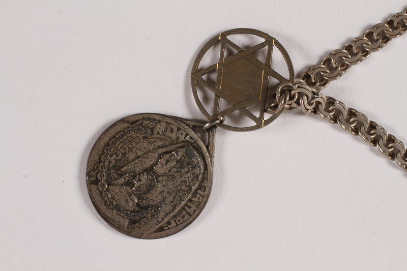 2014.427.7 front Religious POW medal attached to Magen David necklace