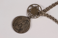 2014.427.7 front Religious POW medal attached to Magen David necklace  Click to enlarge