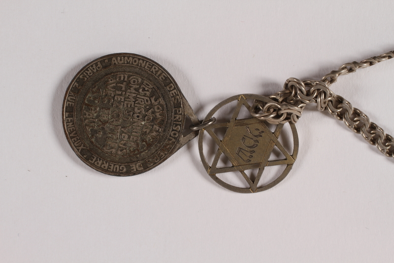 2014.427.7 back Religious POW medal attached to Magen David necklace