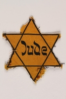 1989.303.55 front Star of David badge with Jude owned by Czech Jewish concentration camp prisoners  Click to enlarge