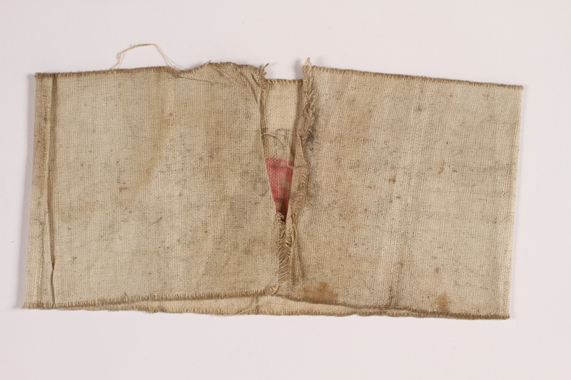 2014.450.3 back White cloth armband worn by a Roman Catholic Polish firefighter in Warsaw