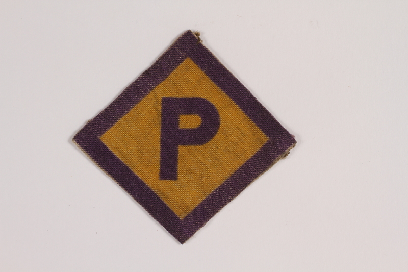 2014.450.4 front Forced labor badge worn by a Roman Catholic Polish youth