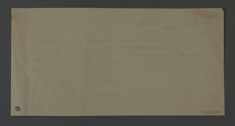 1995.89.635 back Blank permit from the Kovno ghetto