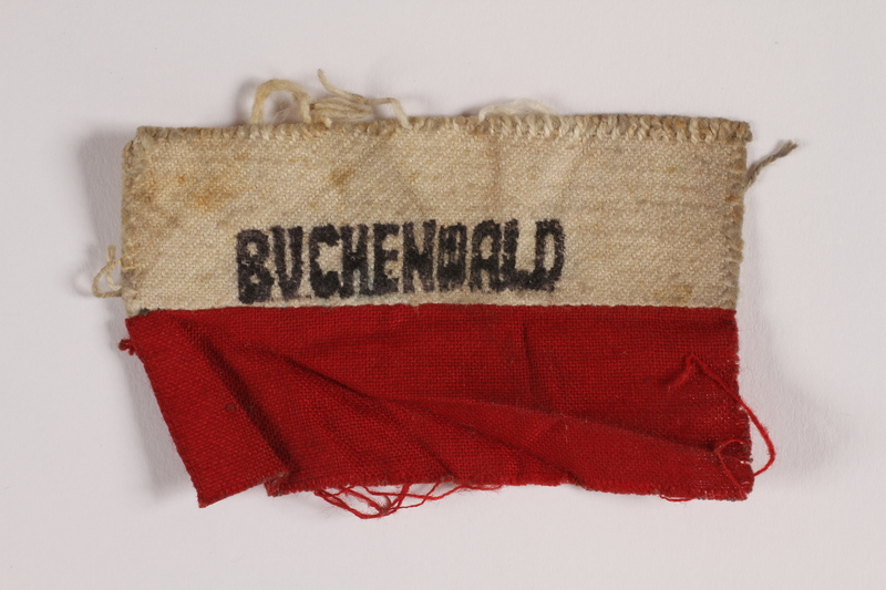 2014.461.2 front Red and white patch stenciled Buchenwald worn by a Polish Jewish inmate
