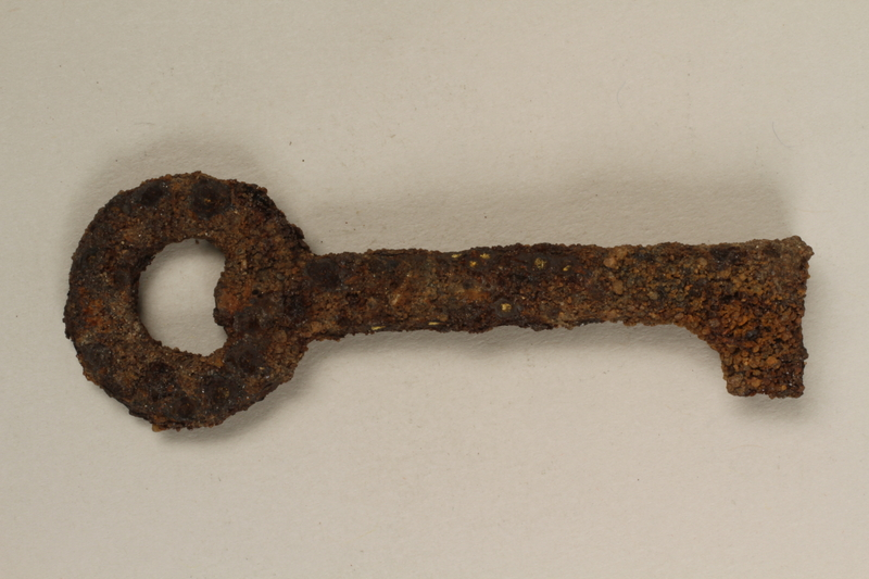 1989.308.15 front Small metal key recovered from Chelmno killing center