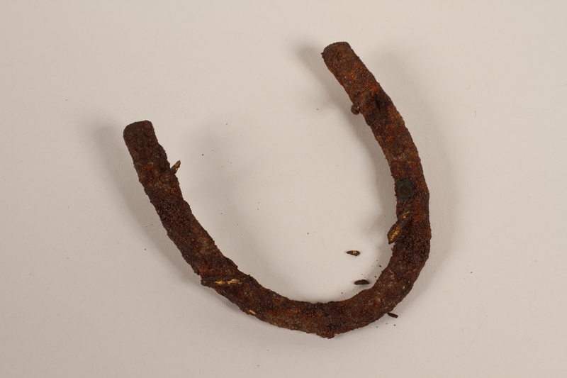 1989.308.18 front Metal horseshoe-shaped heel plate recovered from Chelmno killing center