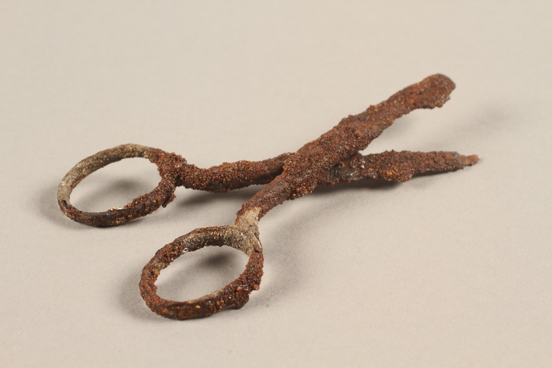 1989.308.19 a-b 3/4 view Small scissors in two pieces, recovered from Chelmno killing center