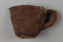Rusted, crushed cup recovered from Chelmno killing center
