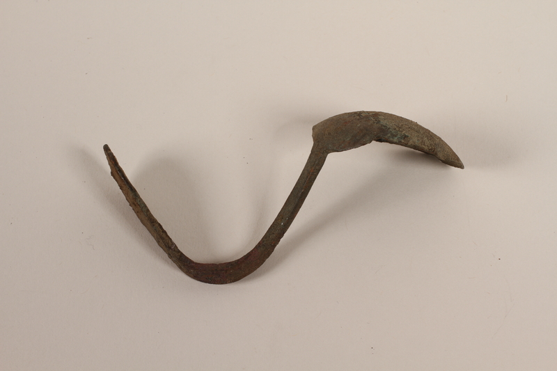 1989.308.21 front Metal teaspoon recovered from Chelmno killing center