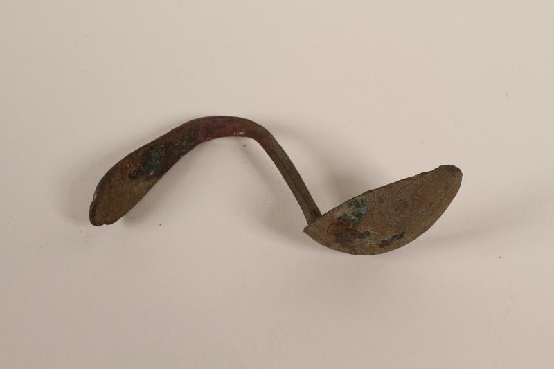 1989.308.21 side Metal teaspoon recovered from Chelmno killing center