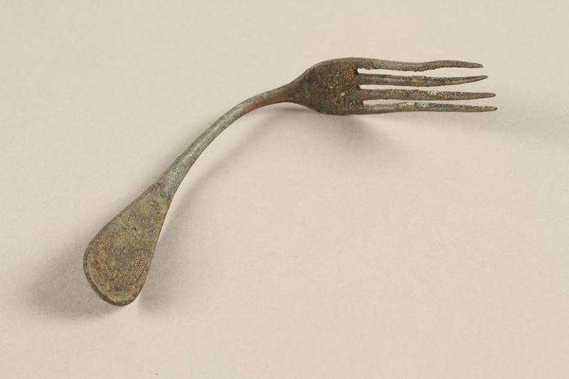 1989.308.22 front Bent metal fork recovered from Chelmno killing center