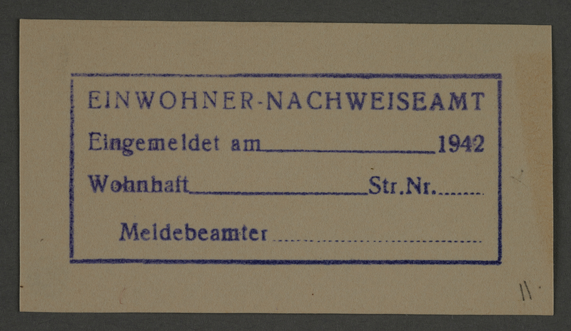 1995.89.805 front Housing department stamp impression from the Kovno ghetto
