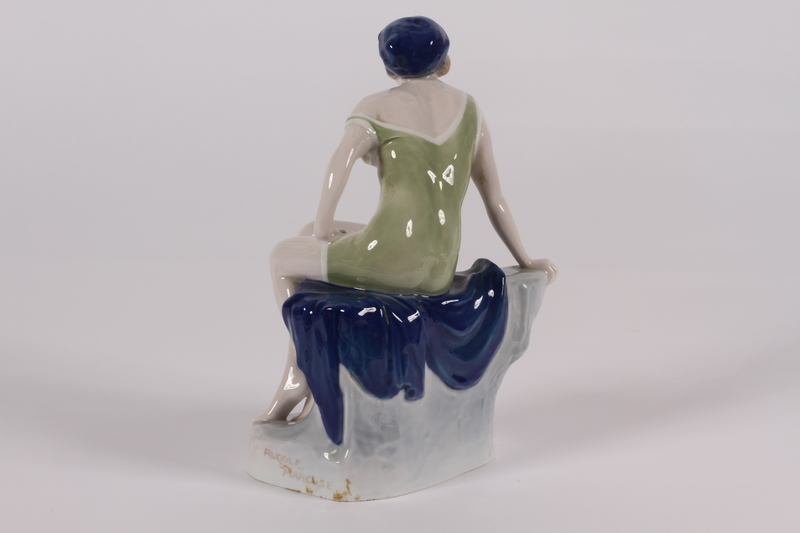2014.470.2 back Porcelain figurine of a seated female acquired from Adolf Hitler's Munich apartment