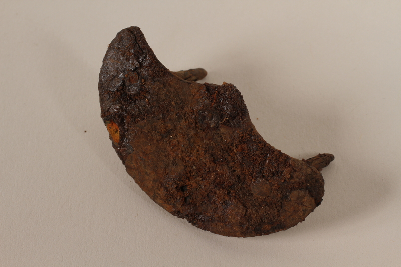 1989.308.26 front Corroded metal heel plate recovered from Chelmno killing center