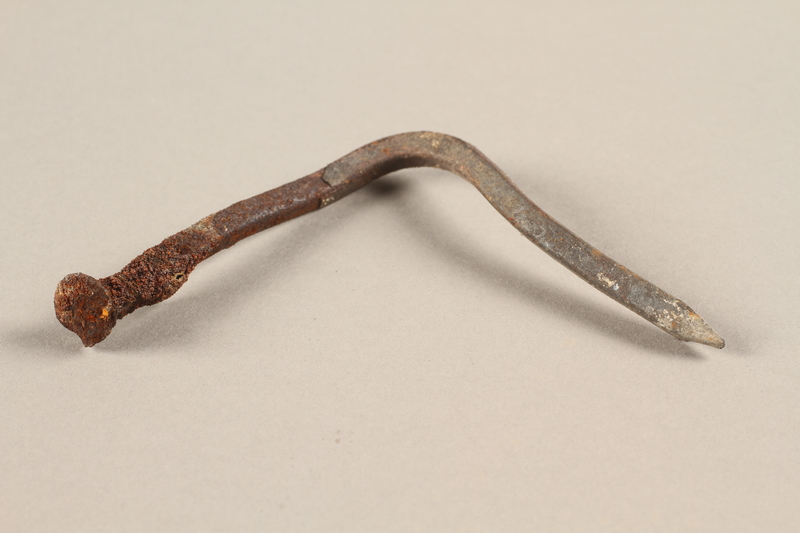 1989.308.28 side b Nail recovered from Chelmno killing center
