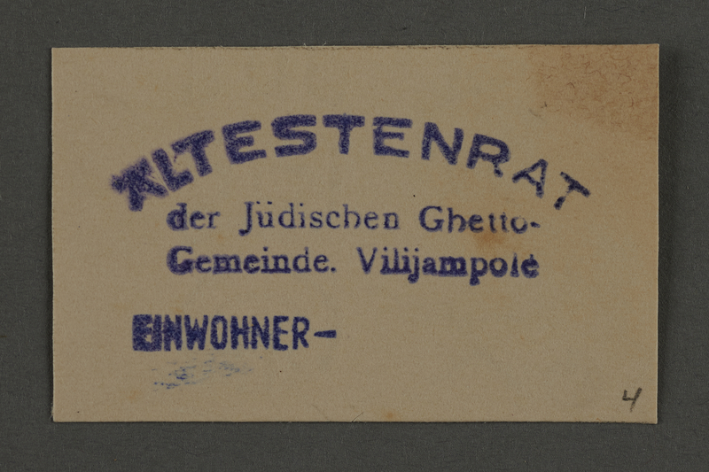 1995.89.874 front Housing department stamp impression from the Kovno ghetto