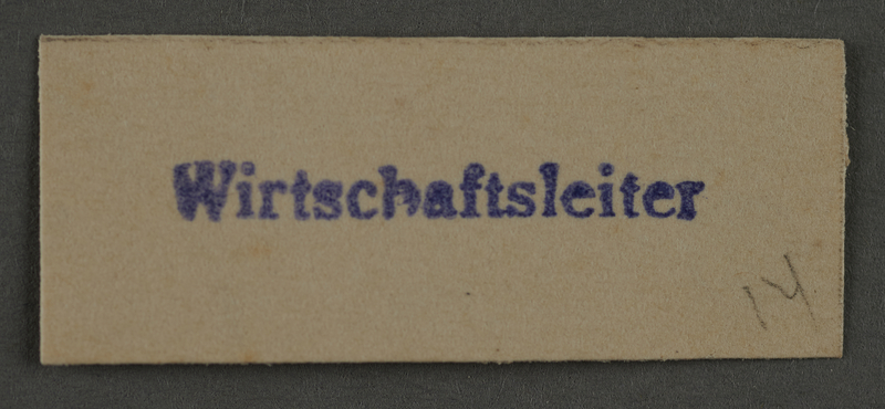 1995.89.887 front Ink stamp impression from an administrative department of the Kovno ghetto