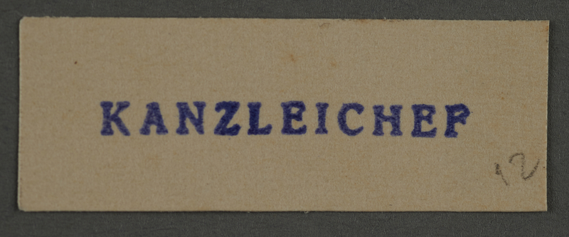 1995.89.892 front Ink stamp impression from an administrative department of the Kovno ghetto