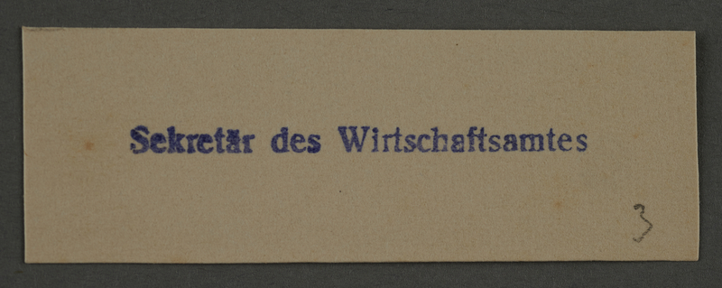 1995.89.900 front Ink stamp impression from an administrative department of the Kovno ghetto