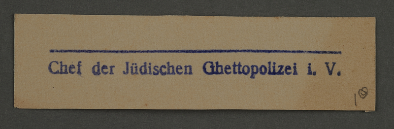 1995.89.904 front Ink stamp impression from an administrative department of the Kovno ghetto