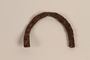 Rusted horseshoe-shaped heelplate recovered from Chelmno killing center