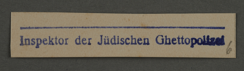 1995.89.908 front Ink stamp impression from an administrative department of the Kovno ghetto