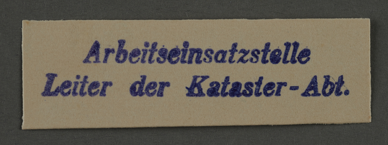 1995.89.911 front Labor Department stamp impression from the Kovno ghetto