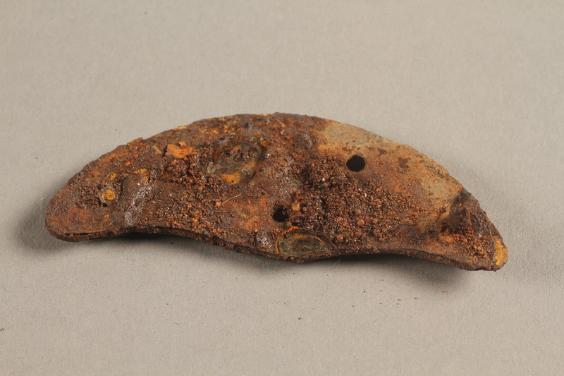 1989.308.6 side a Rusted heel plate with screw recovered from Chelmno killing center