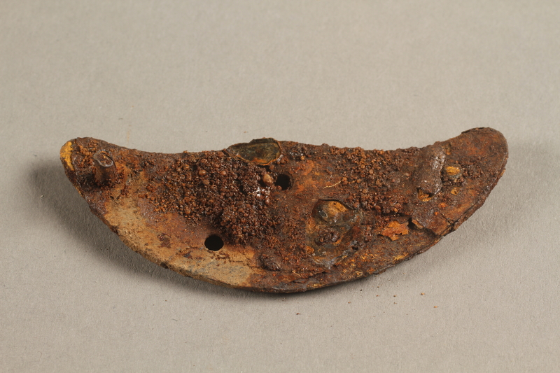 1989.308.6 side b Rusted heel plate with screw recovered from Chelmno killing center