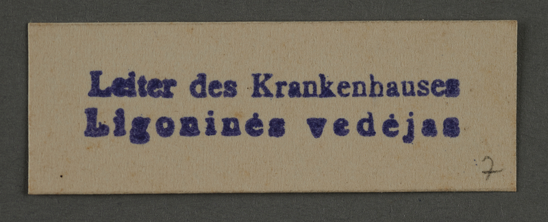 1995.89.915 front Ink stamp impression from an administrative department of the Kovno ghetto