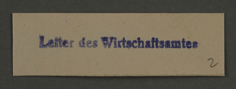 1995.89.919 front Ink stamp impression from an administrative department of the Kovno ghetto
