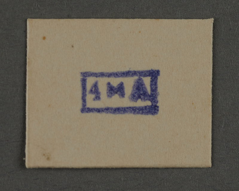 1995.89.933 front Ink stamp impression from an administrative department of the Kovno ghetto