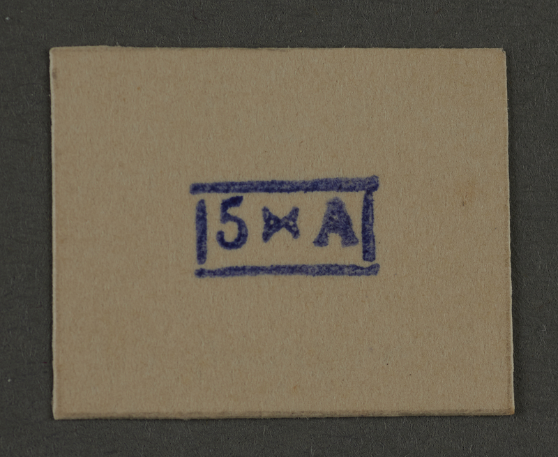1995.89.935 front Ink stamp impression from an administrative department of the Kovno ghetto