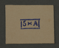 1995.89.935 front Ink stamp impression from an administrative department of the Kovno ghetto  Click to enlarge