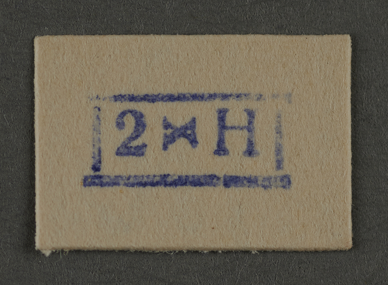 1995.89.936 front Ink stamp impression from an administrative department of the Kovno ghetto