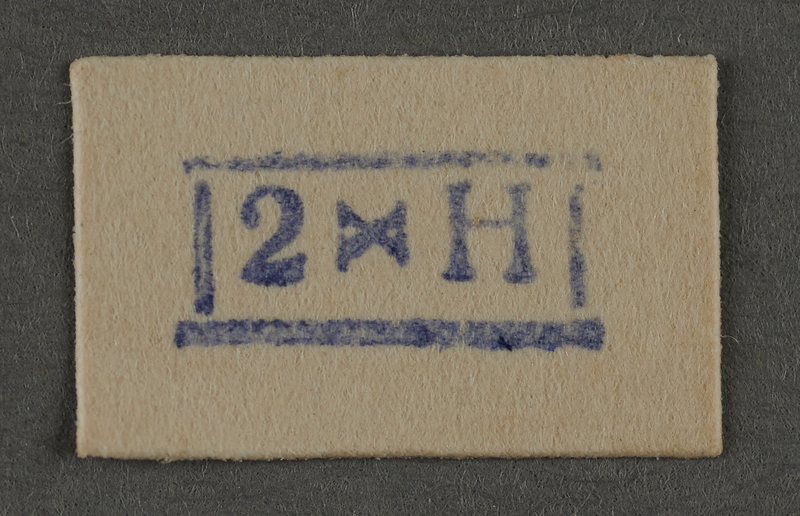 1995.89.937 front Ink stamp impression from an administrative department of the Kovno ghetto