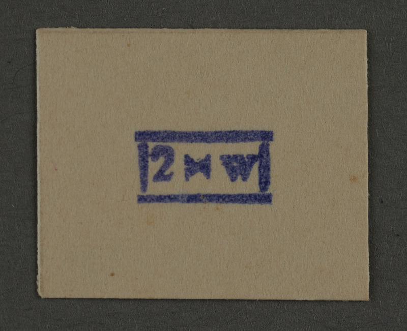 1995.89.939 front Ink stamp impression from an administrative department of the Kovno ghetto
