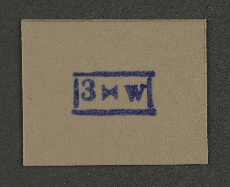 1995.89.940 front Ink stamp impression from an administrative department of the Kovno ghetto