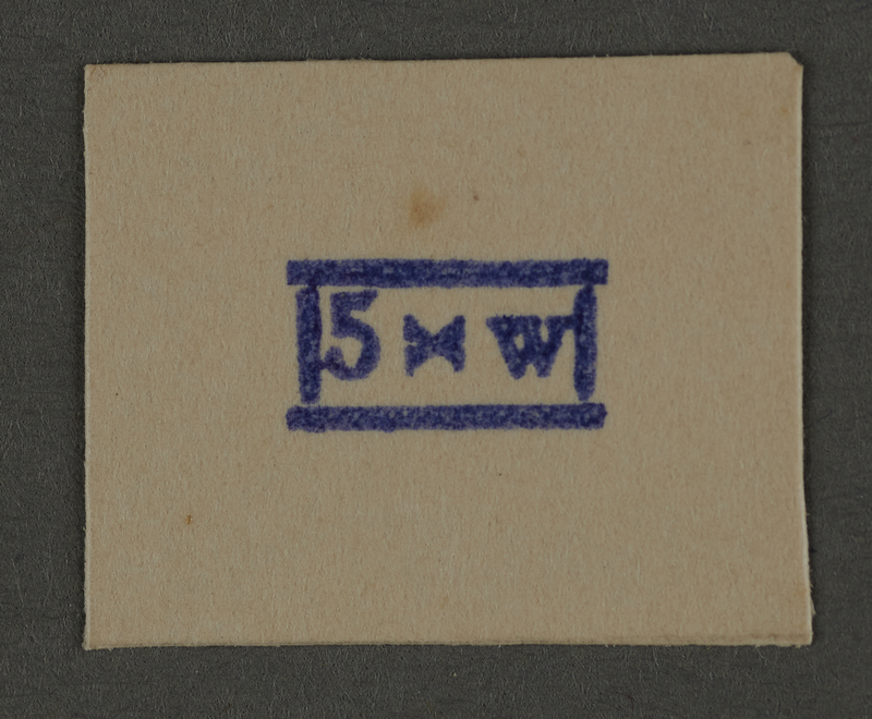 1995.89.942 front Ink stamp impression from an administrative department of the Kovno ghetto