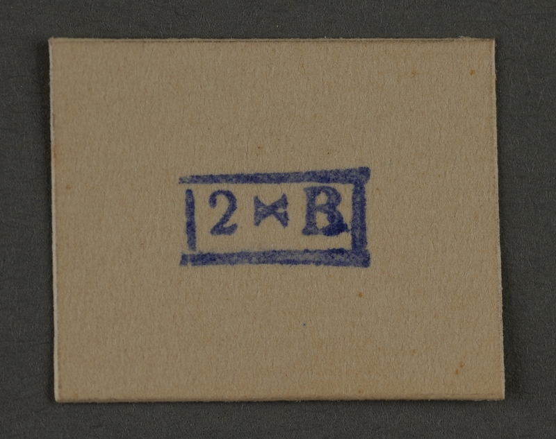 1995.89.943 front Ink stamp impression from an administrative department of the Kovno ghetto